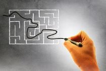 Businessman finding a solution to a problem - The way out of a labyrinth