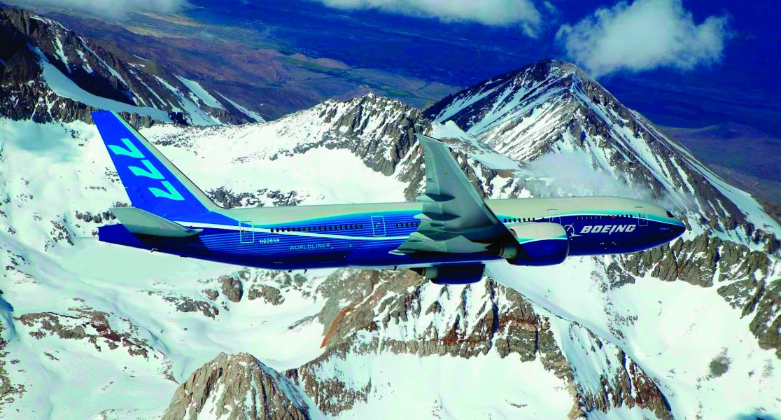 boeing_777 200lr_banking_over_mountain